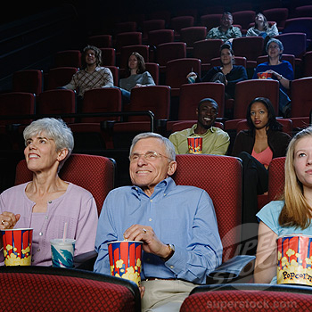 People Watching a Movie in Movie Theatre