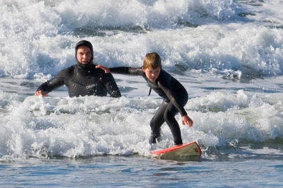 Father_and_son_surf_lesson_in_Morro_Bay,_CA.jpg